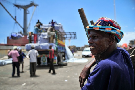 Somalia's seaport bustles with business as trucks come to off load ships of their cargo. AU-UN IST PHOTO / TOBIN JONES.